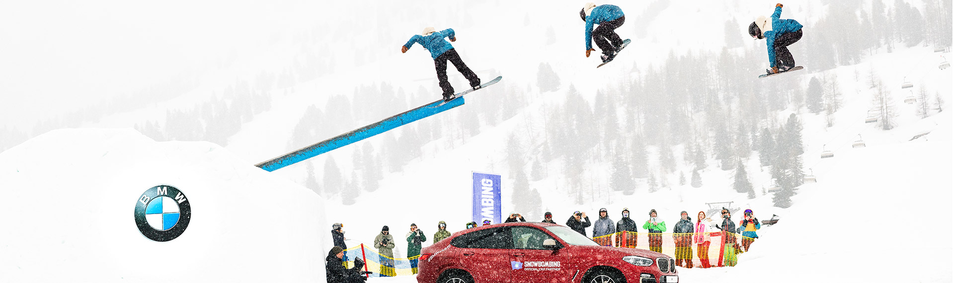 Snowboarder Billy Morgan jumping over the BMW X4.