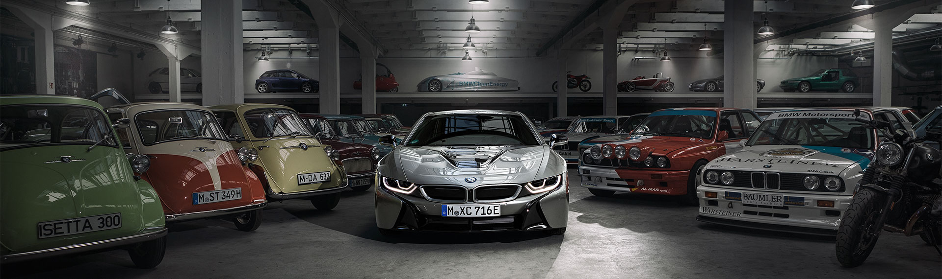 BMW i8 in garage with classic BMW range
