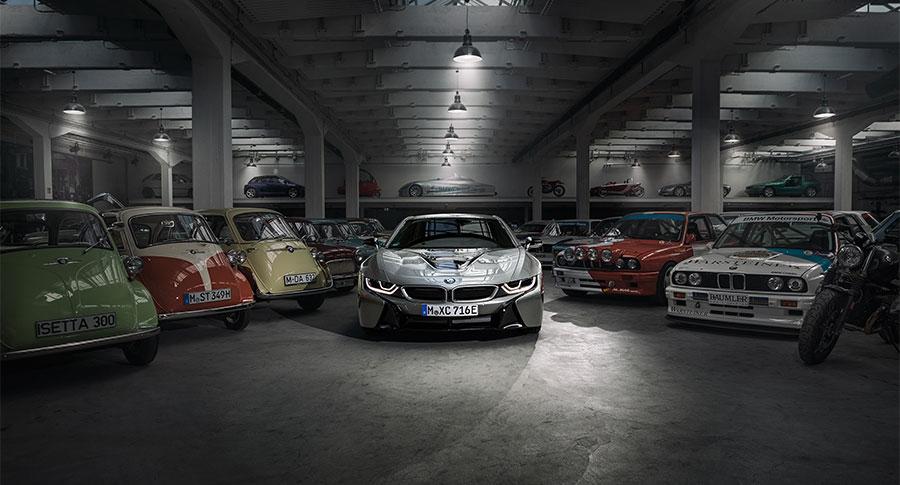 BMW i8 in garage with classic BMW range