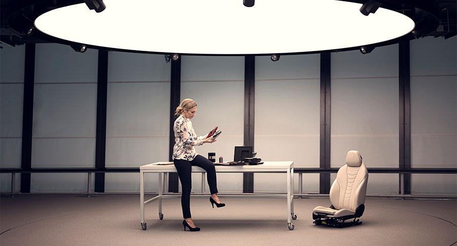 Designer Susanne Kraus sitting on work table