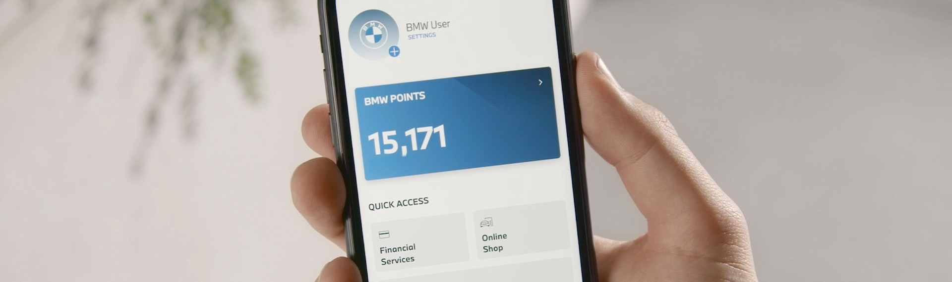 Smartphone showing BMW Points earned.