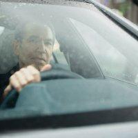 Jeff Koons driving.