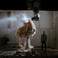 Jeff Koons working with sculpture.